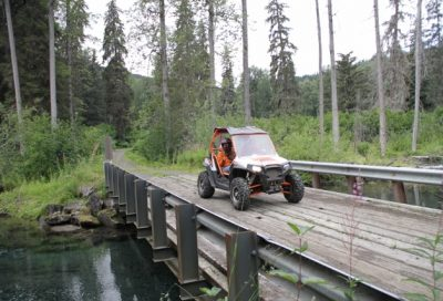 Crossing over a salmon spawning stream on the Last Frontier ATV Adventure