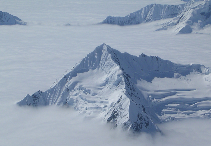 An unnamed peak rising above the cloud layer