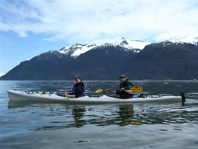 Guests paddle stable tandem sea kayaks