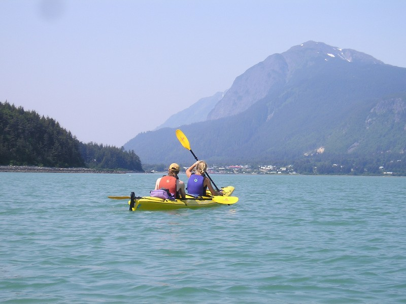 Paddle tandem kayaks just outside of Haines, AK
